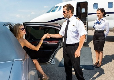 DTY0X3 Pilot Helping Elegant Woman Stepping Out Of Car